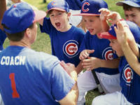 Little league baseball coach with team
